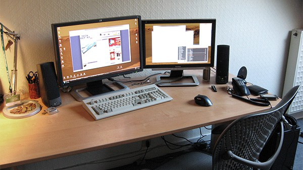 two computer monitor, keyboard, mouse and desk